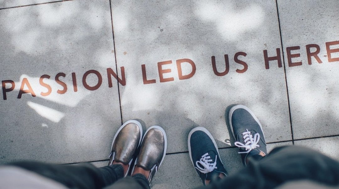 Sidewalk with text and people standing