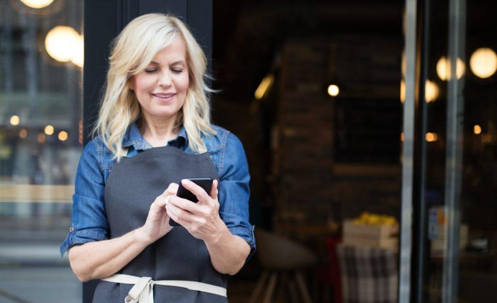 Frontline Female Staff on her Mobile