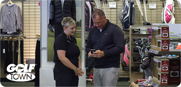 Golf store associates using their phone