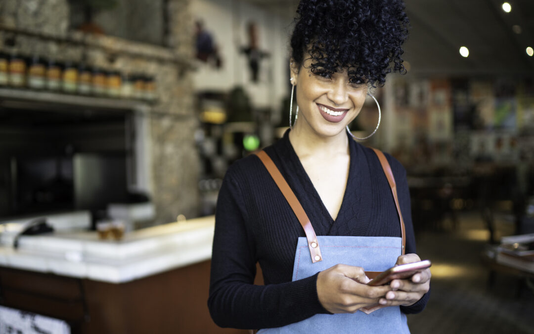 Communication Effectiveness - Foodservice employee smiling at phone | Nudge